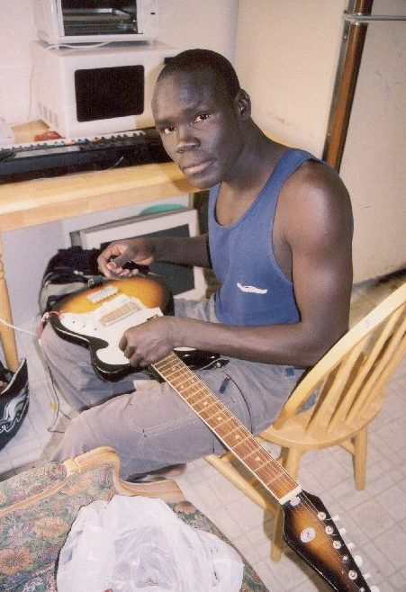 Alepho tuning a guitar.