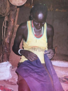 Alepho and Benson's Mother in her hut in Juol, South Sudan