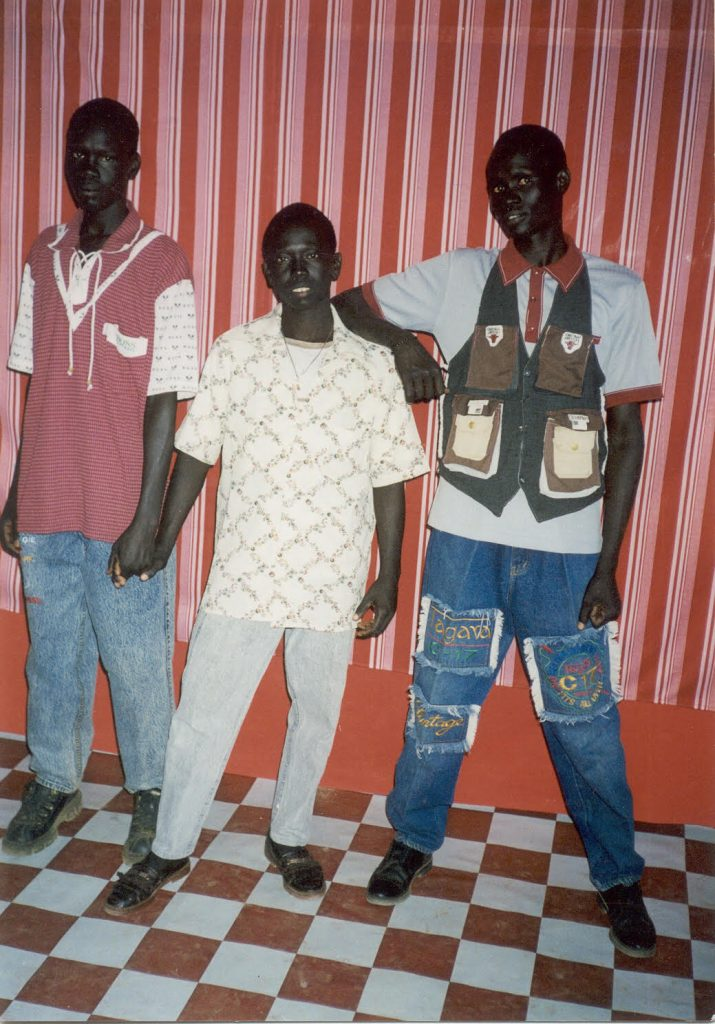 Alepho, Angelo (friend), and Benson in photo booth in Kakuma Refugee Camp